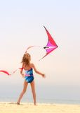 Playing with the kite Stock Images