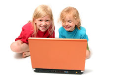 Playing on laptop Stock Photography