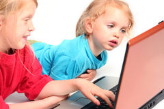 Playing on laptop Stock Photo
