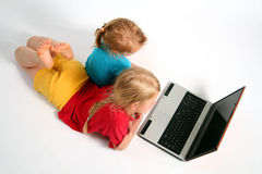 Playing on laptop Royalty Free Stock Photography