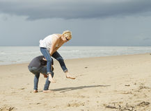 Playing leapfrog on the beach royalty free stock photo