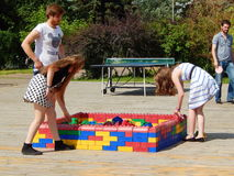 Playing lego. Summertime in the Gorky park in Moscow. Royalty Free Stock Photo