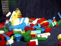 Playing with Legos. Playing with Lego blocks, studio shot stock video footage