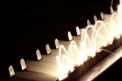 Playing with light. Playing the piano with light Stock Image