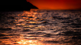 Playing with light. Sea ripples reflecting the sunlight Stock Photos