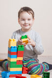 Playing little boy with colored cubes Royalty Free Stock Images