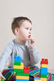 Playing little boy with colored cubes Royalty Free Stock Photography
