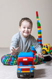 Playing little boy with colored cubes Royalty Free Stock Photo