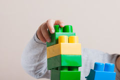 Playing little boy with colored cubes Stock Photography