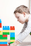 Playing little boy with cubes Stock Image