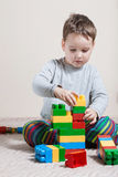Playing little boy with cubes Royalty Free Stock Image