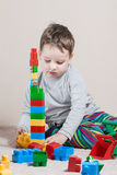 Playing little boy with cubes Royalty Free Stock Images