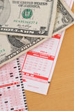 Playing Lotto. With Cash And Lottery Ticket Royalty Free Stock Photo