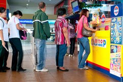 Playing Lotto. Baguio City,Philippines - People of all walks of life lining up to bet for the lotto jackpot prize Royalty Free Stock Images