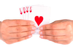 Playing with love. Love sign on playing cards in female hand Stock Photo