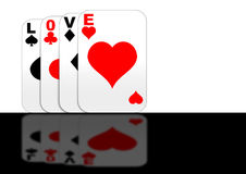 Playing with Love gaming cards standing. Playing cards with love standing on a reflective surface Royalty Free Stock Photography