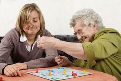 Playing ludo. Grandmother and granddaughter playing ludo Royalty Free Stock Photo