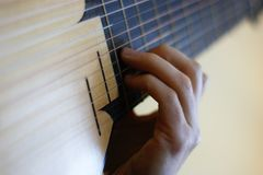 Playing the lute right hand stock image