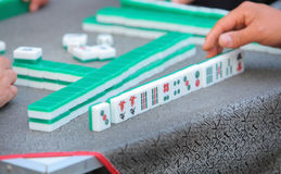 Playing mahjong. Plays mahjong is a populace entertainment project in China royalty free stock photos
