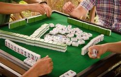 Playing mahjong. The Chinese entertainment - playing mahjong royalty free stock photography
