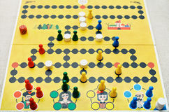Playing in Malefiz - family board game Royalty Free Stock Photos