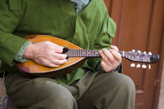Playing mandolin Royalty Free Stock Photo