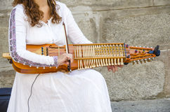 Playing a medieval instrument Stock Photography
