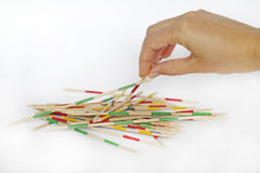 Playing mikado game pick-up sticks stock images