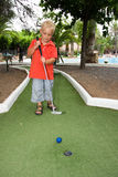 Playing mini golf. Young boy is playing mini golf Stock Photo
