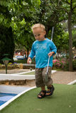 Playing mini golf. Young boy is playing mini golf Royalty Free Stock Photography
