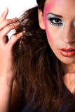 Playing mixed raced girl with extreme make-up royalty free stock photo