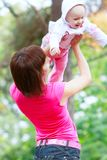Playing mother and toddler girl Stock Images