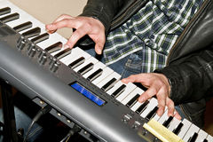 Playing the music keyboard Royalty Free Stock Photography