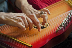 Playing music on lap harp in closeup view Royalty Free Stock Photography