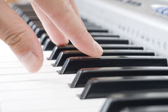 Playing music on the piano Stock Photos