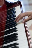 Playing Music on Piano Royalty Free Stock Photos