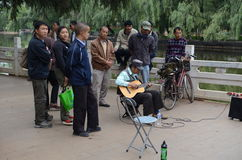 Playing music on the streets of Kunming Stock Image