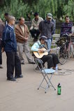 Playing music on the streets of Kunming Royalty Free Stock Photos
