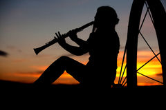 Playing music at sunset. Royalty Free Stock Photography