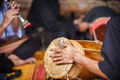 Playing musical instrument. Few young men playing some musical instrument Royalty Free Stock Images