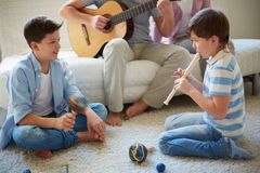 Playing musical instruments Royalty Free Stock Photography