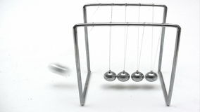 Playing with Newton´s Cradle stock footage