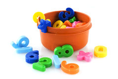 Playing with numbers. Playing with plastic colored numbers at school Royalty Free Stock Photos