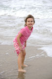Playing in the ocean. A young girl playing in the ocean stock photos