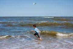 Playing at an ocean coast Royalty Free Stock Photo