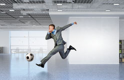 Playing office soccer Stock Images