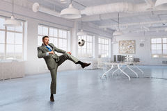 Playing office soccer . Mixed media Royalty Free Stock Photos