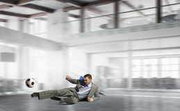 Playing office soccer . Mixed media Stock Photo
