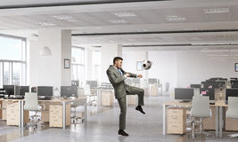 Playing office soccer . Mixed media Stock Images
