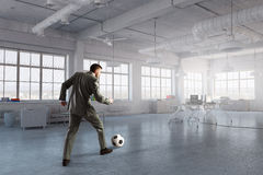 Playing office soccer . Mixed media Stock Image